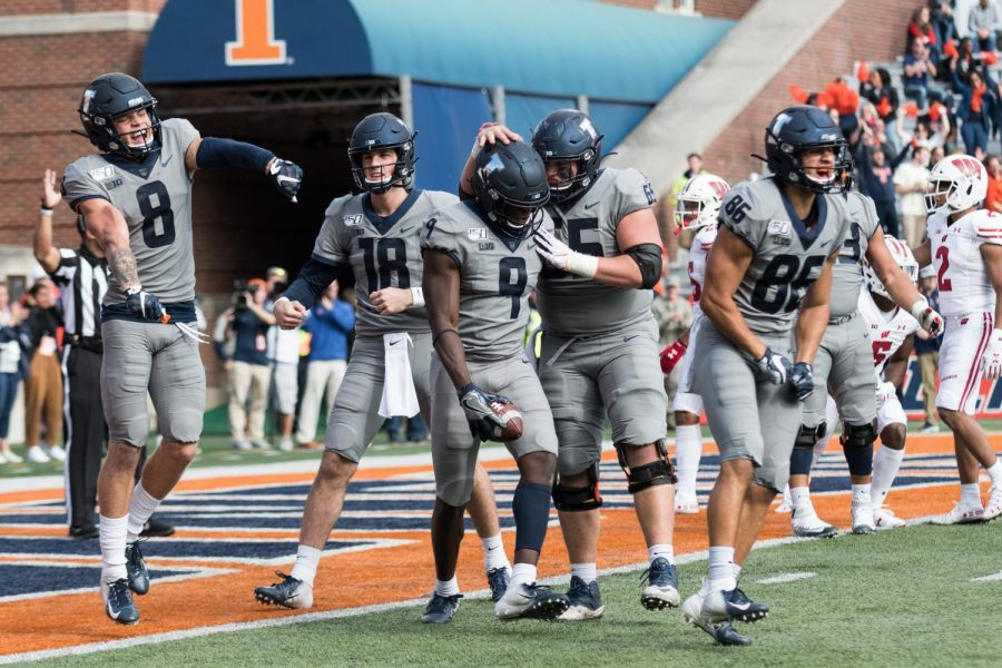 Illinois+wide+reveiver+Josh+Imatorbhebhe+and+teammates+celebrate+a+touchdown+during+the+game+against+Wisconsin.++The+Illini+won+24-23.