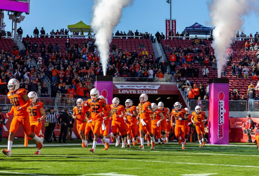 The Illini football team run out onto Levis Stadium for the Redbox Bowl in California on Dec. 30.