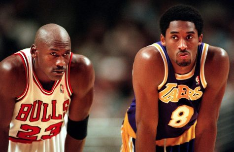 Michael Jordan and Kobe Bryant look on during free throws during a game at the United Center on Dec. 19, 1997.
