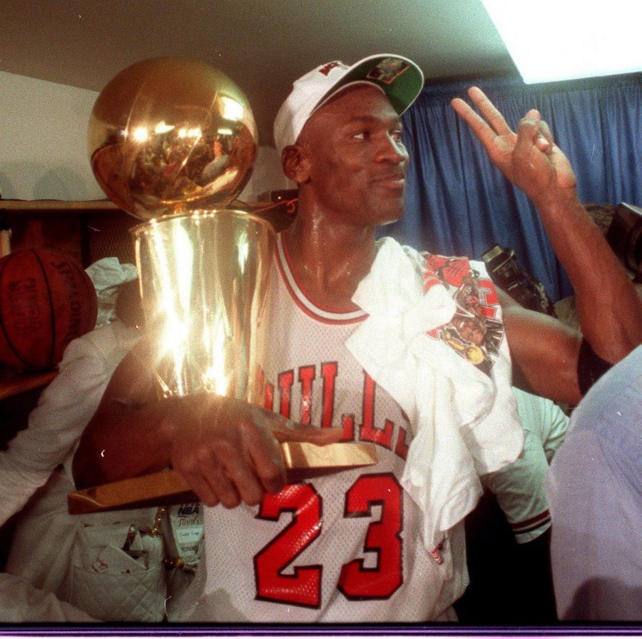 Michael+Jordan+holds+onto+the+NBA+Championship+trophy+after+the+Bulls+won+their+second+straight+title+on+June+14%2C+1992.