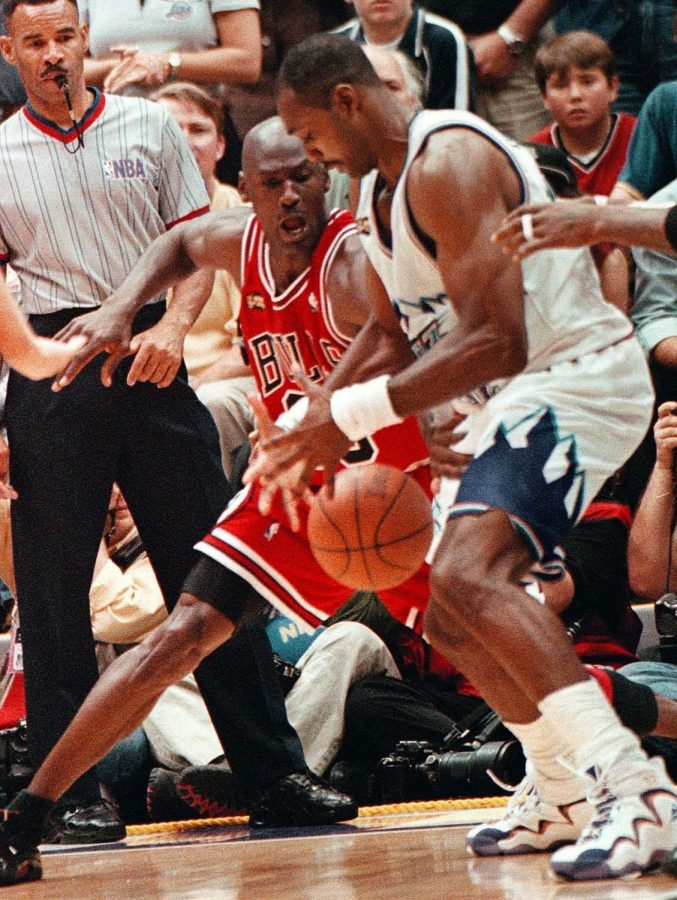 Bulls guard Michael Jordan steals the ball from Jazz forward Karl Malone during Game 6 of the NBA Finals at the Delta Center in Salt Lake City on Sunday, June 14, 1998. Jordan took the ball and drove to the basket to hit the game-winning shot.