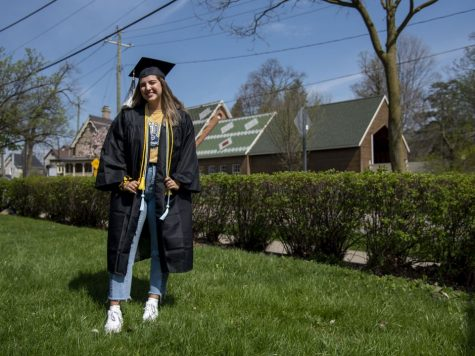 A college senior poses for a photo outside of her home on May 2, 2020.