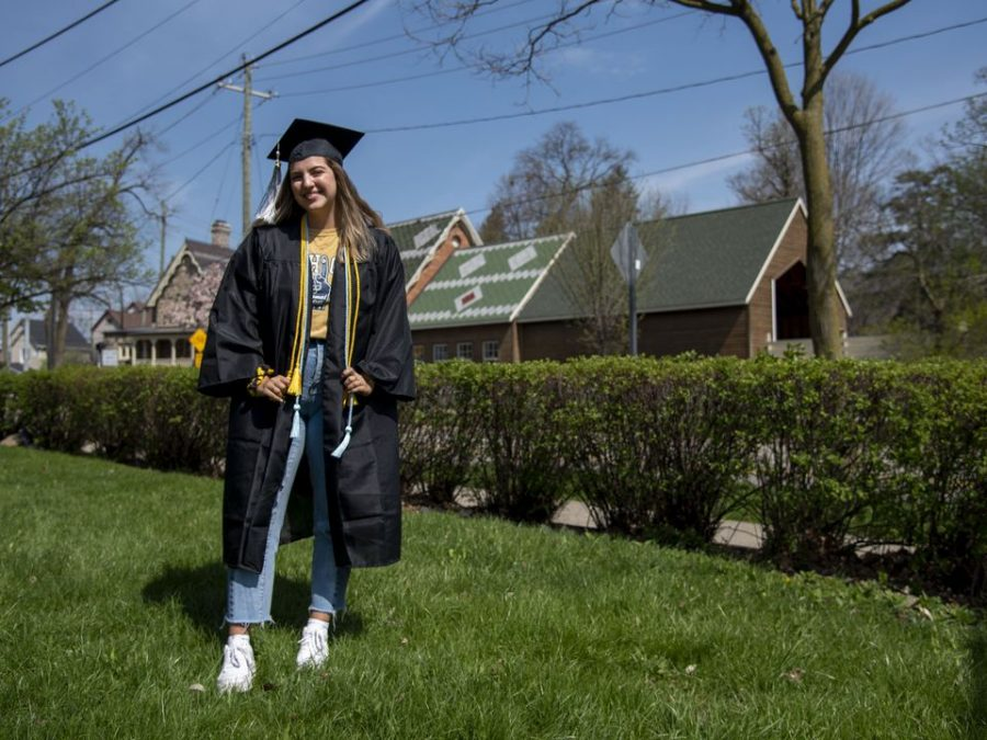 A+college+senior+poses+for+a+photo+outside+of+her+home+on+May+2%2C+2020.