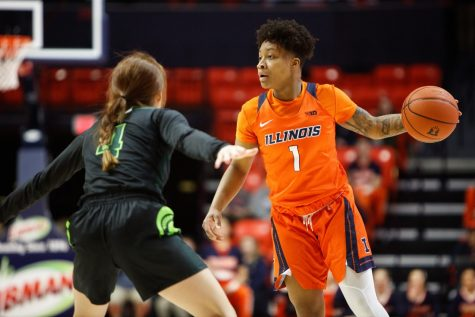 Guard Brandi Beasley dribbles the ball during the Illinois' game against Michigan State at State Farm Center on Feb. 26.