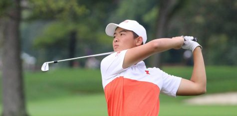 Freshman Jerry Ji watches the arc of his ball after taking a swing during competition.
