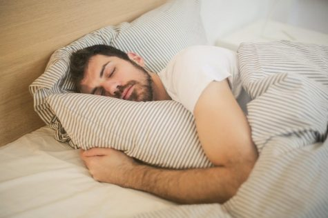 A man sleeps in his bed on Feb. 19.