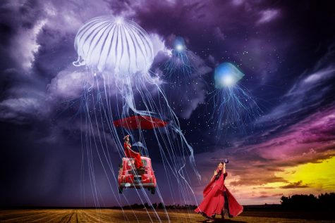 Two women are seen in a field surrounded by dark skies and flying jellyfish.