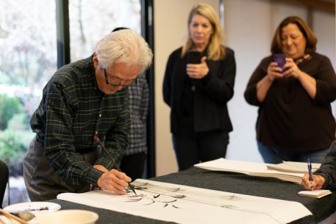 University Art and Design Professor Shazo Sato explains how to paint  bamboo with black ink. Here he teaches his Black Ink Painting class at the Japan House on Nov. 17, 2019.