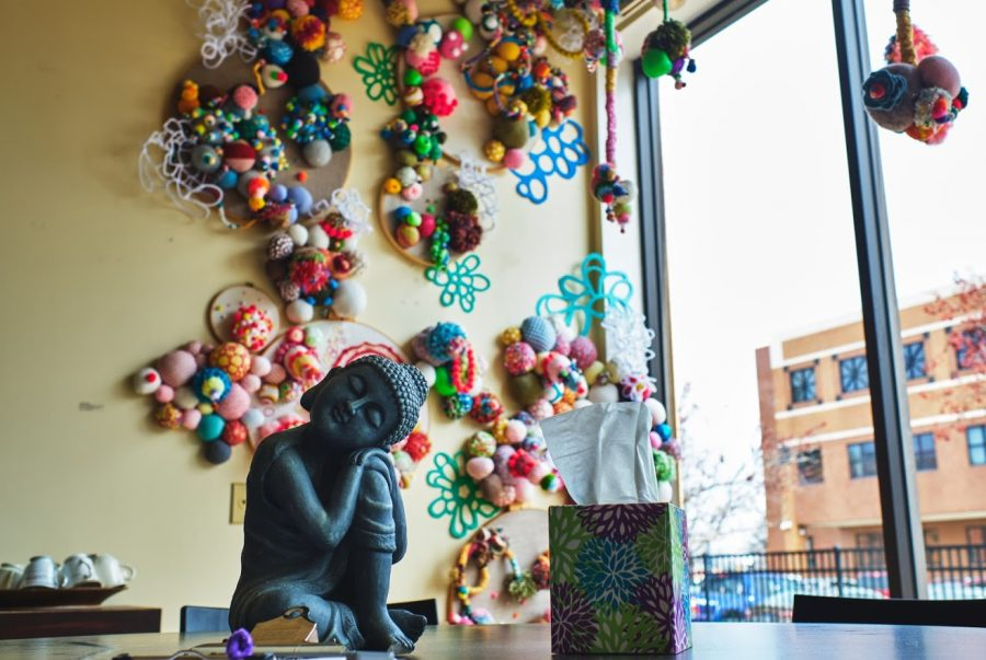 A buddha statue stands on a table of Amara and Arts Yoga Studio located in Urbana on Jan. 22.