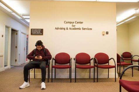 Adrian Martinez, a freshman in DGS, waits to meet with his advisor on March 5, 2019 in the Campus Center for Advising & Academic Services on Wright St.