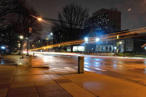 Cars travel up and down the road at the intersection of 4th and Armory late on the night of March 26.