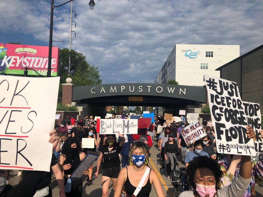 Protesters march down Green St. in Champaign, IL on Monday following the death of George Floyd in Minneapolis, Minnesota on May 25.