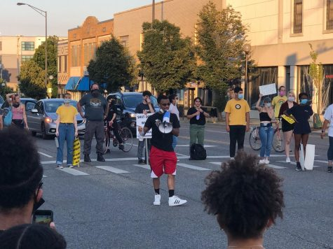 Drake Materre speaks to demonstrators  on Tuesday during a protest sparked by the reinstatement of the Urbana Police Chief Bryant Seraphin.