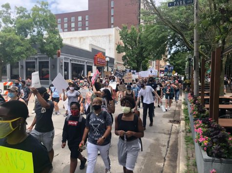 Demonstrators march south on Neil Street during a protest in Champaign, IL on Sunday.