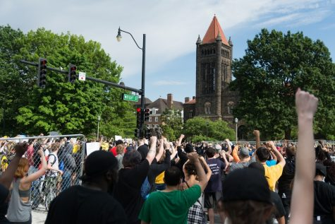 Protestors gather at the intersection of Green and Wright streets.