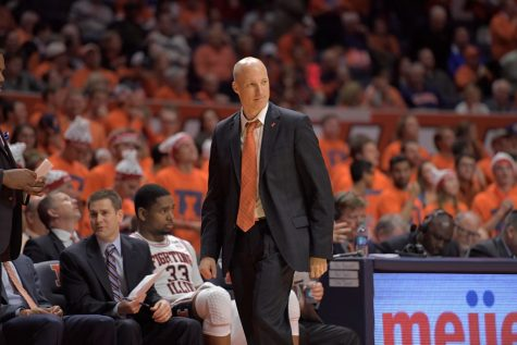 Former Illinois Head Basketball Coach John Groce looks toward the court during the match against NC State on Nov. 29, 2016.