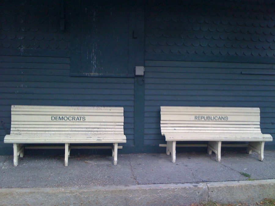 At the MBTA Prides Crossing commuter rail station in Beverly, MA, there are 2 benches on the street side of the former station house. They are marked