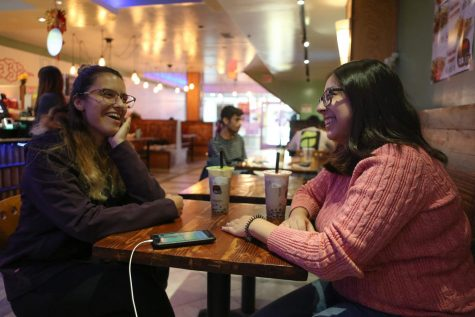 Two Illinois students enjoy time with each other at Kung Fu Tea in Champaign on Oct. 18. 2019.