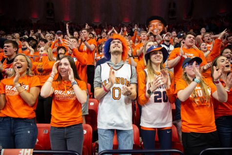 University students in the Orange Krush fan section cheer for the Illini basketball team during their match against Iowa on March 8. In the fall, there will still be opportunities for sports fans to support Illinois' teams while keeping up social distancing.