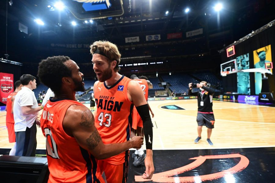 House of Paign player Mike Daum celebrates with teammate Kyle Vinales after winning their match against Carmen's Crew in The Basketball Tournament on Wednesday.