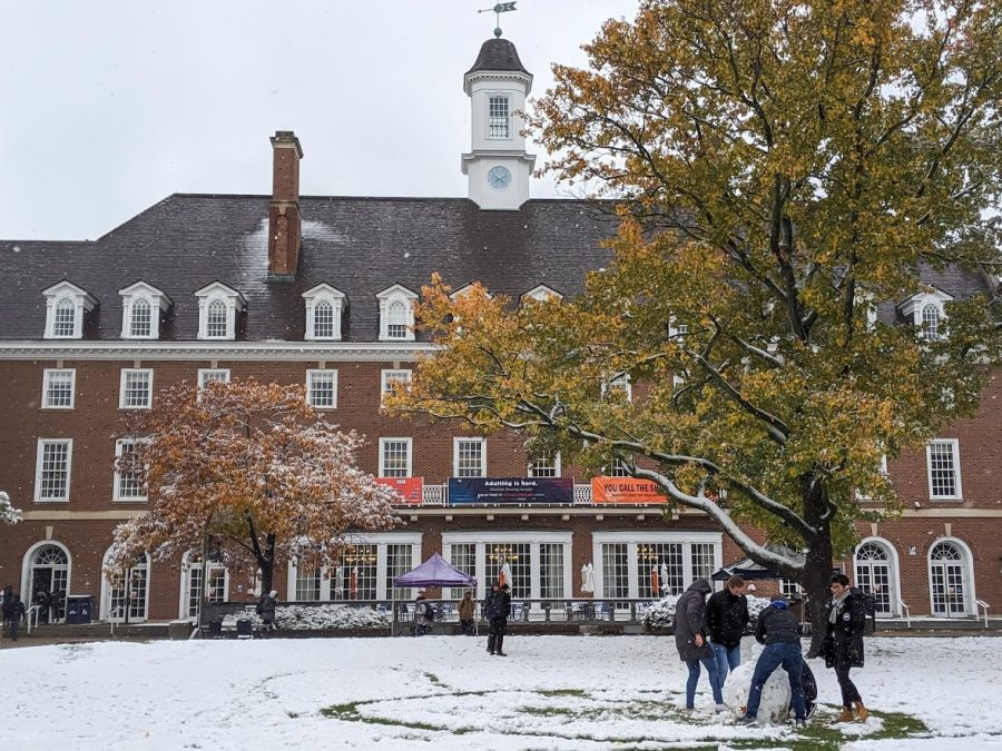 Students build a snowman on the quad in front of the Illini Union on Oct. 31, 2019.