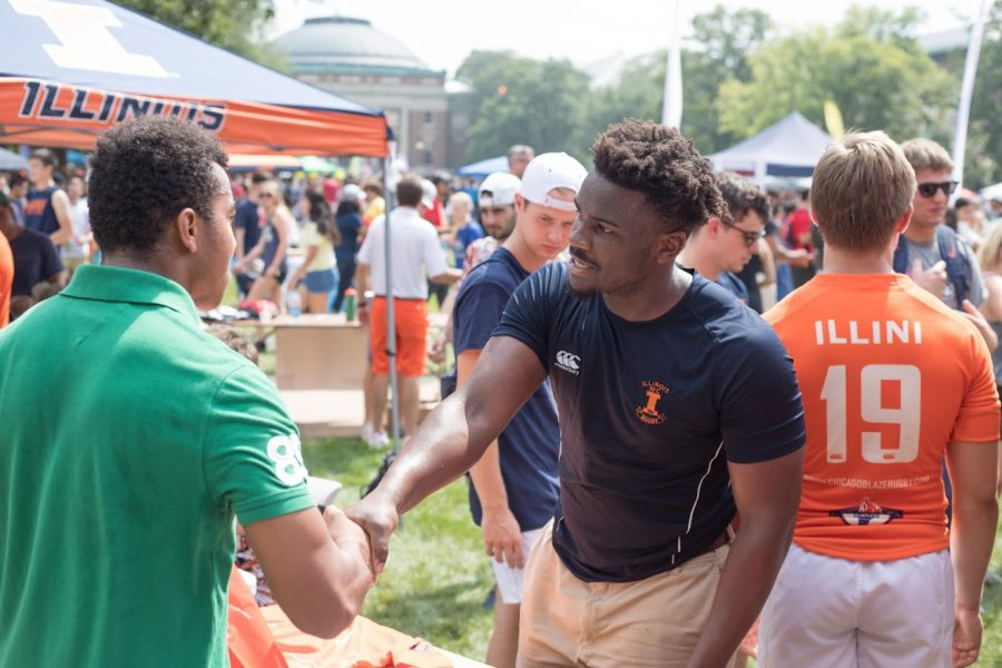 A representative for a RSO greets a student during Quad Day on Aug. 26, 2018.