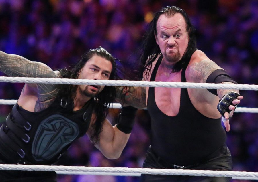 The Undertaker, right, throws Roman Reigns during WrestleMania 33 at Camping World Stadium in Orlando, FL. in 2017.