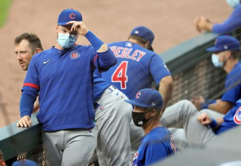 Chicago Cubs center fielder Ian Happ wears a mask in the dugout on July 20, 2020 during an exhibition game at Guaranteed Rate Park.