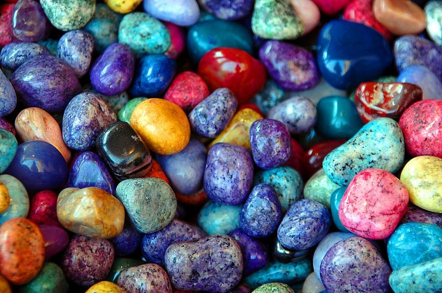 A collection of colorful rocks lay in a pile.