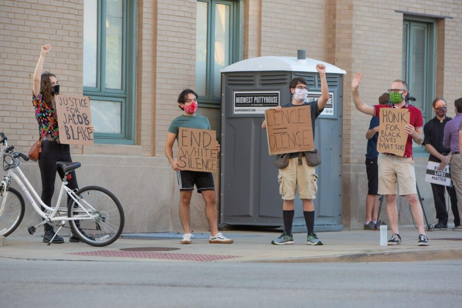 Demonstrators+stand+outside+the+Champaign+City+Building+in+Champaign%2C+IL+on+the+corner+of+University+Ave+and+Walnut+St+in+a+show+of+support+for+Jacob+Blake+on+Wednesday.