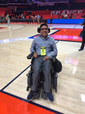 Junior Zain Bando poses for a photo on the court at State Farm Center. Bando called for the University to be held accountable for the closing of Beckwith Residential Support Services Program, which provides support and amenities for students with physical disabilities.