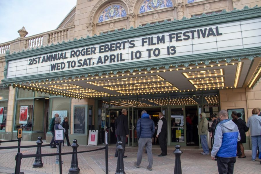 People gather for the Ebert Film Festival at the entrance to the Virginia Theatre on April 10, 2019.