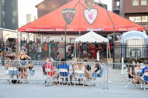 Patrons of The Red Lion sit at newly mandated outdoor seating on Friday. Campustown businesses are carrying out new measures to combat COVID-19 and implement new safety regulations.