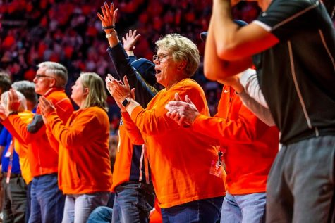 Illini fans cheer from the sidelines at the game against Iowa on March 8. Fans have high expectations for the upcoming season.