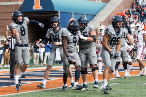 Illinois wide receiver Josh Imatorbhebhe and teammates celebrate a touchdown during the game against Wisconsin on Oct. 19. Big Ten commissioner and the Big Ten Council of Presidents and Chancellors made the decision to postpone the 2020 fall sports season on August 11.