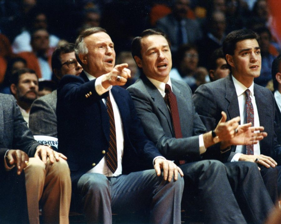 Illinois Head Basketball Coach Lou Henson gestures towards the court during a match.