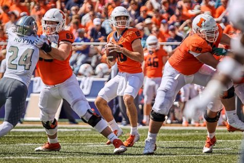 Senior offensive lineman Alex Palczewski protects senior quarterback Brandon Peters during the game against Akron on Sept. 14. The 2020 football season has been postponed to the spring due to COVID-19.