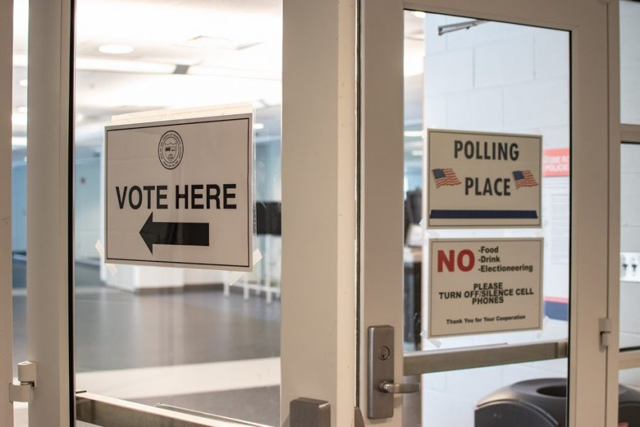 Signs direct voters outside the polling place at the ARC in MP7 on March 6. The ARC will be the only Illinois athletic facility used as a voting location this November.