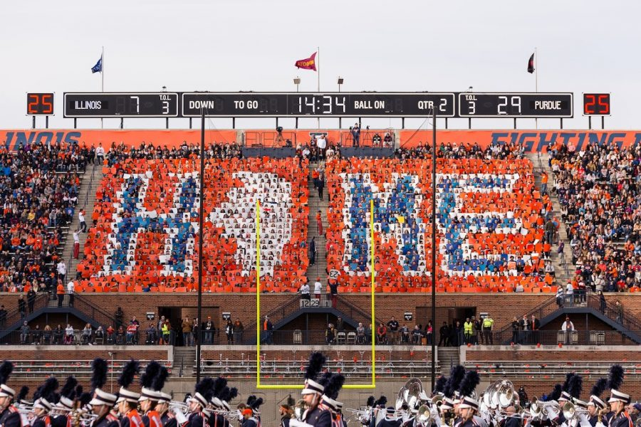 The+Block+I+student+section+holds+up+cards+spelling+%E2%80%9CHome%E2%80%9D+during+halftime+of+the+game+against+Purdue+at+Memorial+Stadium+on+Oct.+13%2C+2018.+Memorial+Stadium%2C+and+all+Illinois+sports+venues%2C+will+return+to+full+capacity+for+the+2021-2022+sports+season.