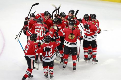 The Chicago Blackhawks celebrate a 3-2 victory against the Edmonton Oilers to win Game 4 and clinch the Western Conference Qualification Round series at Rogers Place in Edmonton, Alberta, on Aug. 7. After the cancellation of sports in March, the NHL season restarted and is now nearing the quarterfinals.