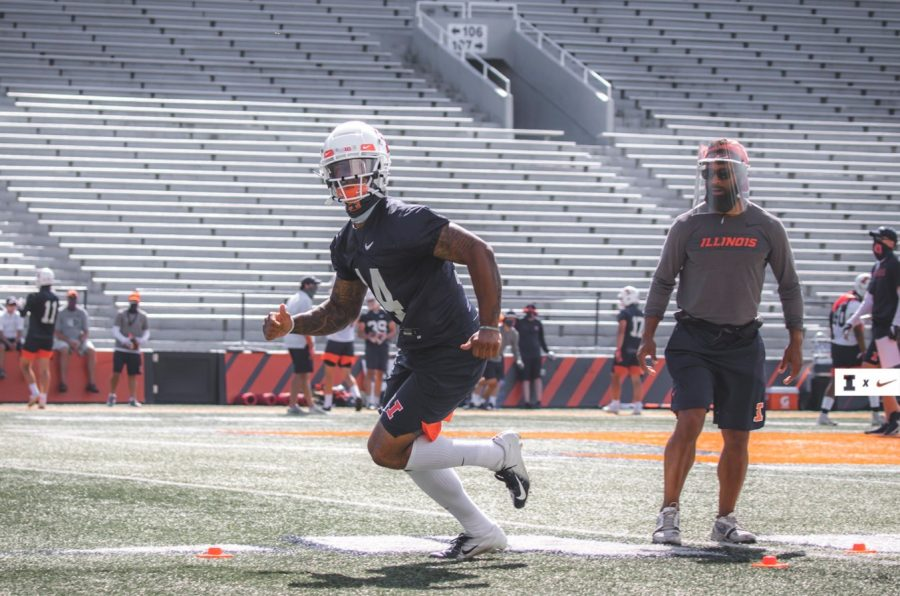 Recently recruited wide receiver Brian Hightower practices drills at Memorial Stadium.