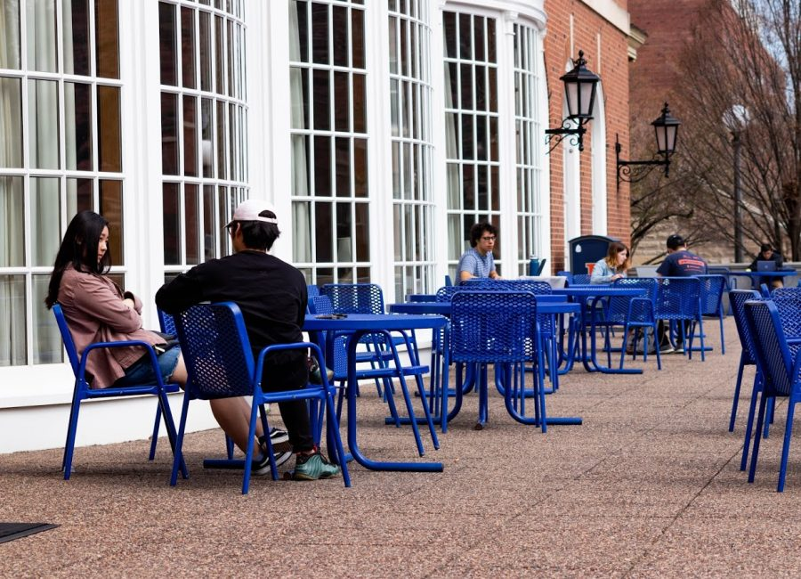 Illinois students study and lounge on the tables outside of the Illini Union on April 3.