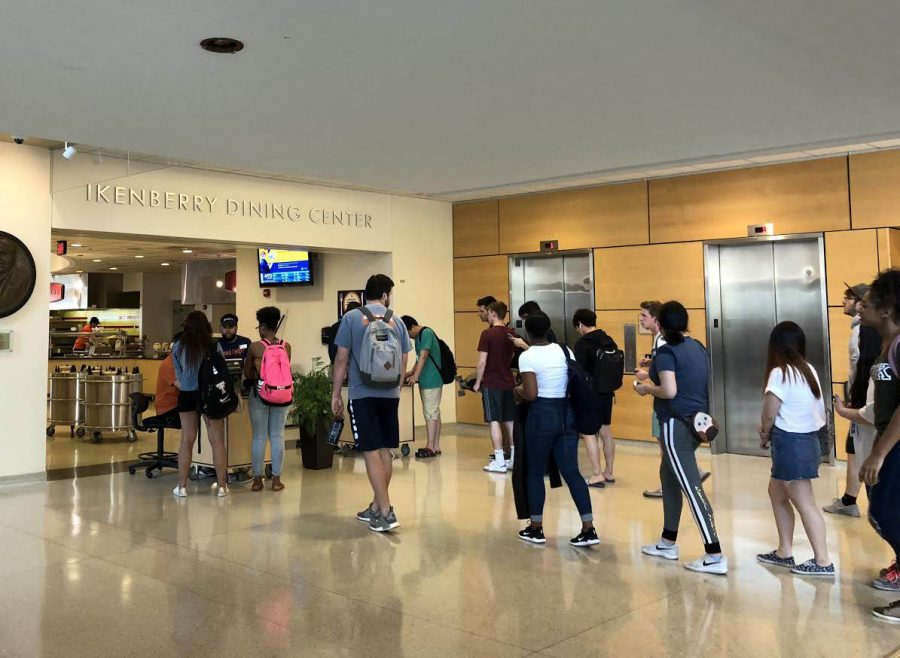 Students wait in line to enter the Ikenberry Dining Center on May 5, 2019.