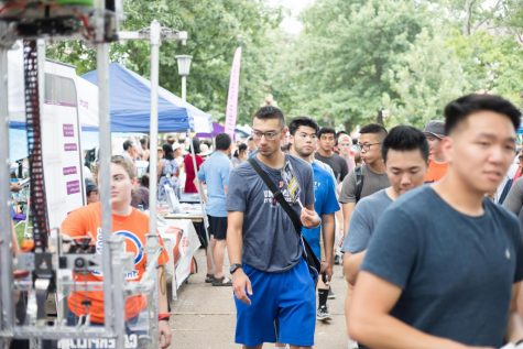 A student looks at an RSO's table as he passes by during Quad Day on Aug. 26, 2018.