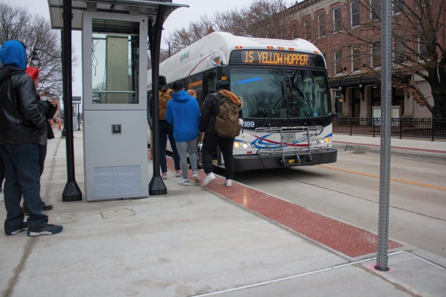 Students board the 1S Yellowhopper bus at Transit Plaza on Jan. 25.