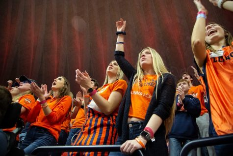 Students in the Orange Krush fan section cheer for the Illini basketball team during their match against Iowa on March 8 at State Farm Center.