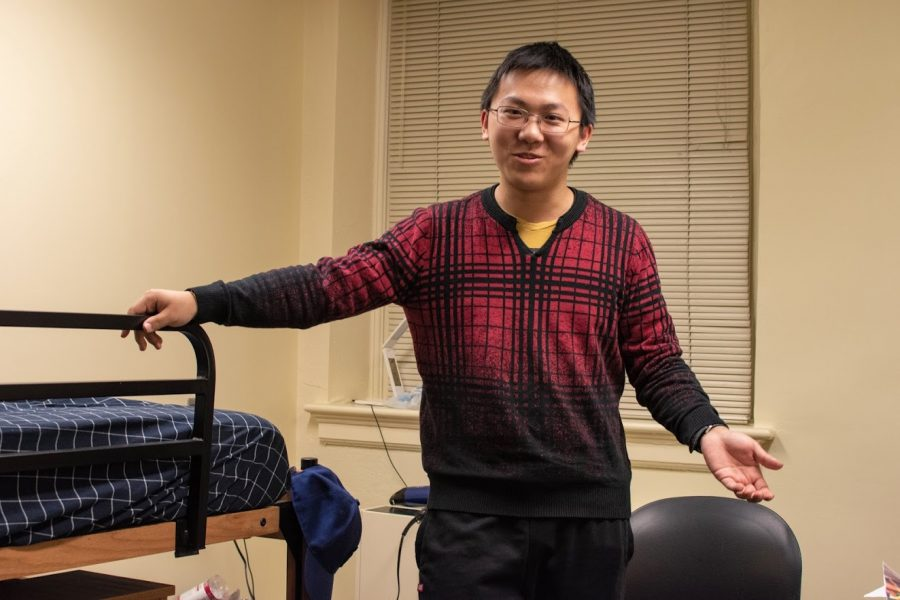 Yuanrui Chen, a sophomore majoring in Electrical Engineering stands in his single dorm room located at Busey-Evans Residence Hall on March 11.