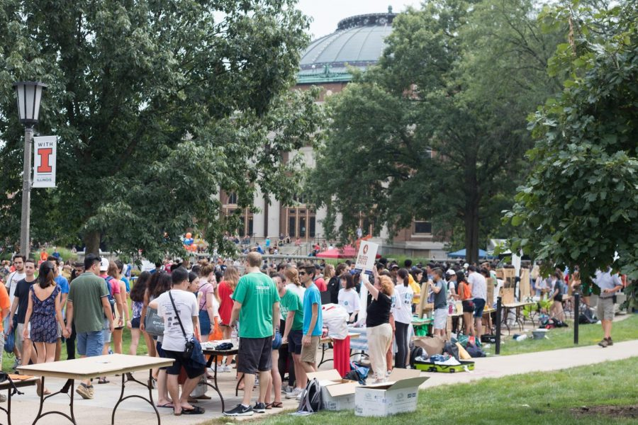 Tables line the edges of walkways on the quad as students inquire about the many RSOs being represented during Quad Day on Aug. 26, 2018.