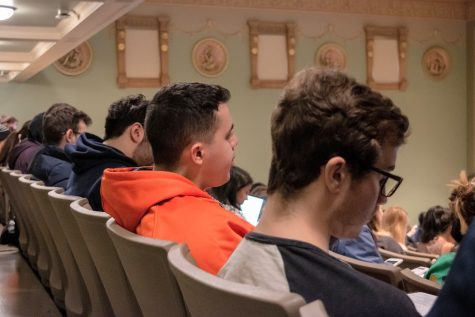 Students enrolled in a Statistics class listen attentively during a lecture at Lincoln Hall Theater on Dec. 3, 2019.