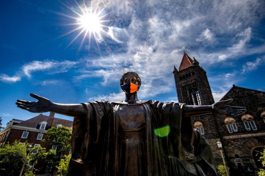 The Alma Mater statue stands tall while wearing a mask on Aug. 3.
